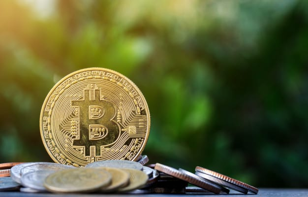 bitcoin-pile-money-wooden-table-nature-background_33779-54