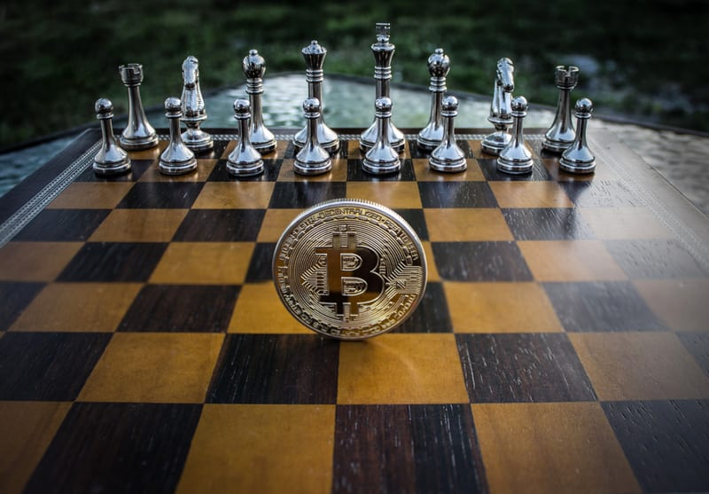 bitcoin-standing-on-a-chess-board_800